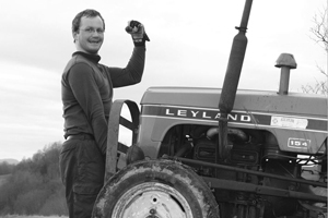 Man lifts tractor with one hand